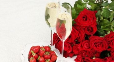 red roses and sparkling wine cropped